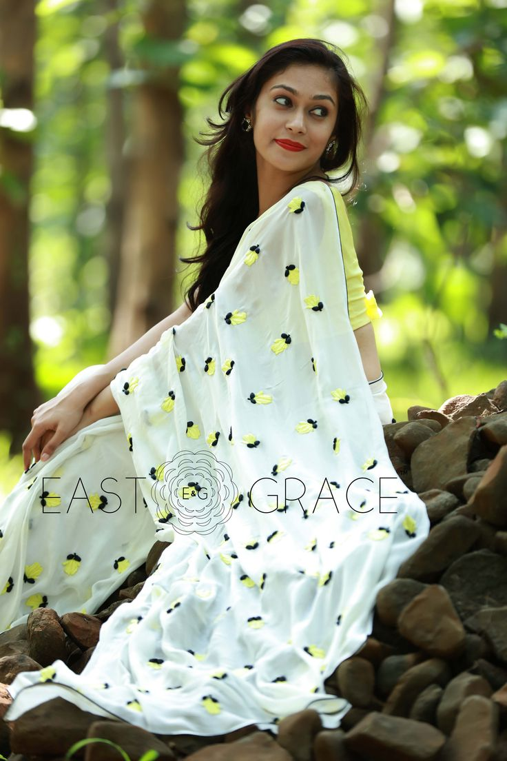 Featuring a white pure silk chiffon saree with windswept yellow crocus flowers embroidered all over, and black ribbonwork sepals and a thin black edging. The sheer white adds the pure, simply sublime, natural grace while the yellow florals add the zest to this breezy, dreamy saree. PRICE: INR 12,400.00; USD 187.88 To buy click here: https://www.eastandgrace.com/products/yellow-crocus For help reach us at care@eastandgrace.com. With love www.eastandgrace.com