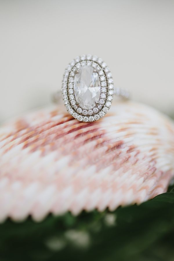 Gorgeous oval engagement ring with a double halo