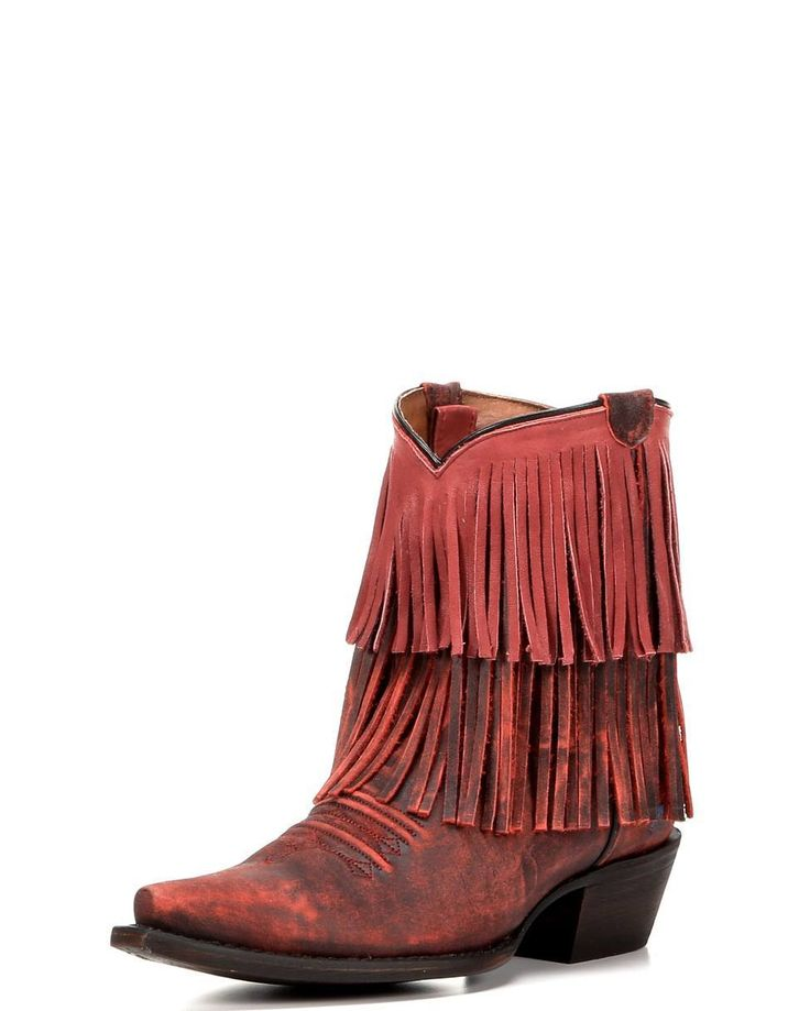 The Red Pepper Fringe Boot by Redneck Riviera is short, but full of spice. This ankle cowboy boot shows off two layers of long leather fringe and smokey vintage red leather. Pull straps are concealed inside for effortless on and off, while a cushioned 3-layer insole ensures lasting comfort. These short boots are versatile and ready to pair with skirts, shorts & skinny jeans. Bring the party in red cowgirl boots by John Rich! <br>Redneck Riviera has created a line of authentic South...