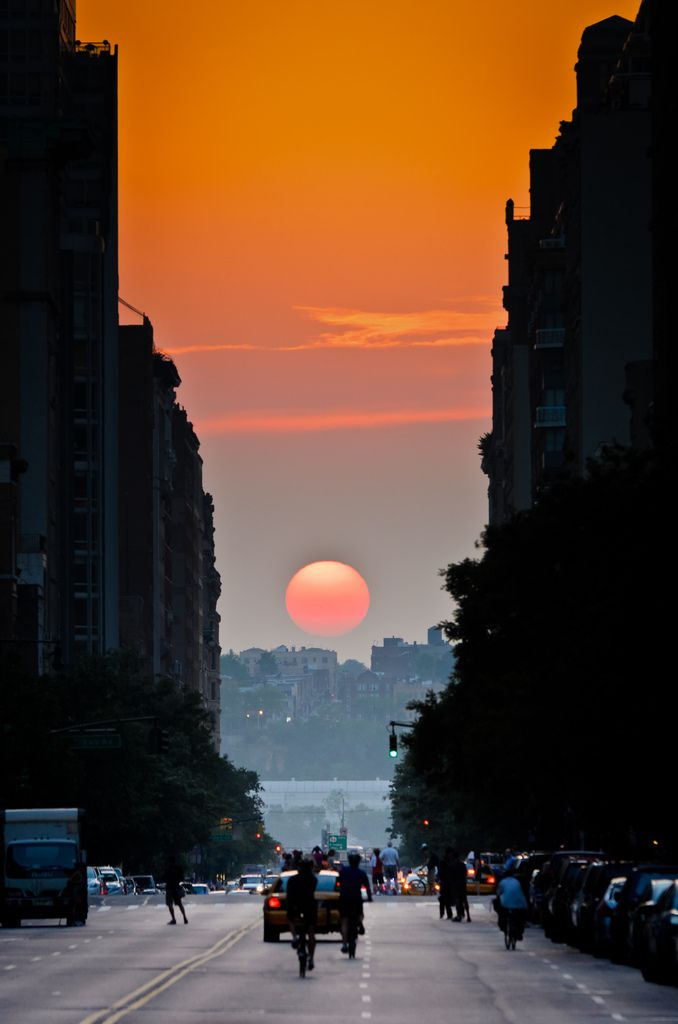 "Twice a year, New Yorkers get a chance to experience ""Manhattanhenge"", the occurrence where the setting sun aligns perfectly with east-west streets."