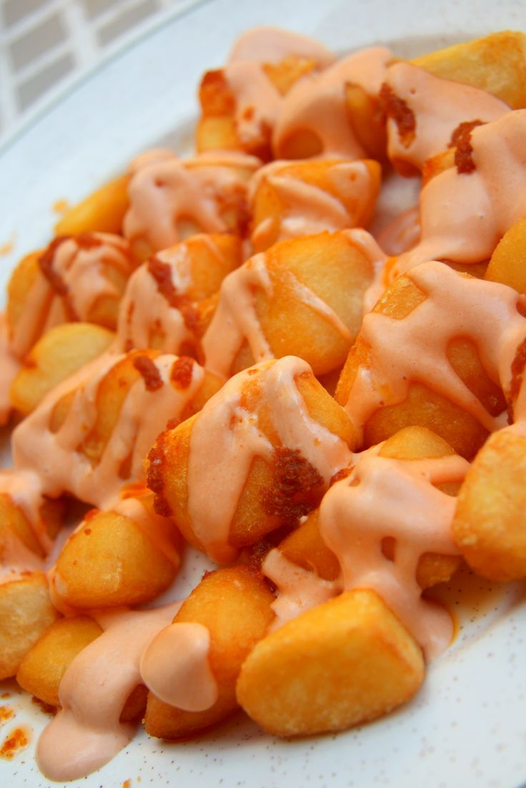 Patatas Bravas is a classic Spanish dish of fried potato cubes served with a spicy dipping sauce.
