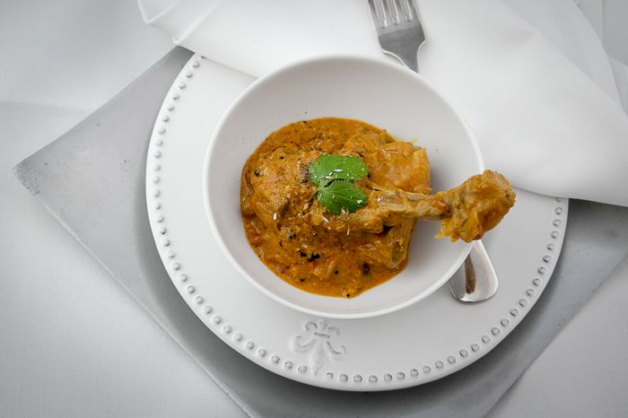 Skinned duck slowly simmered in coconut milk extract and red chilli, seasoned with coriander and fennel powder.