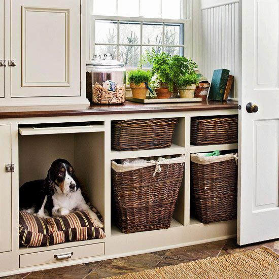 This tucked-away dog bed can be hidden by a pull-down cabinet when not in use. See more creative ideas for dog beds: http://www.bhg.com/pets/dogs/cool-dog-bed-ideas-/?socsrc=bhgpin040913hiddendogbed