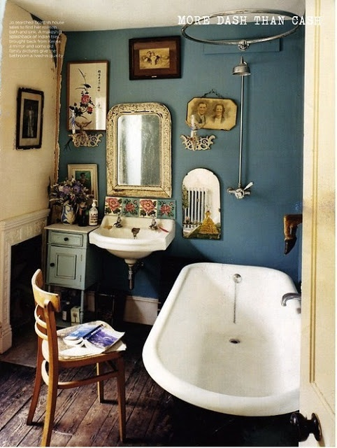blue wall. gold accents. wood. pictures. LOVE this.