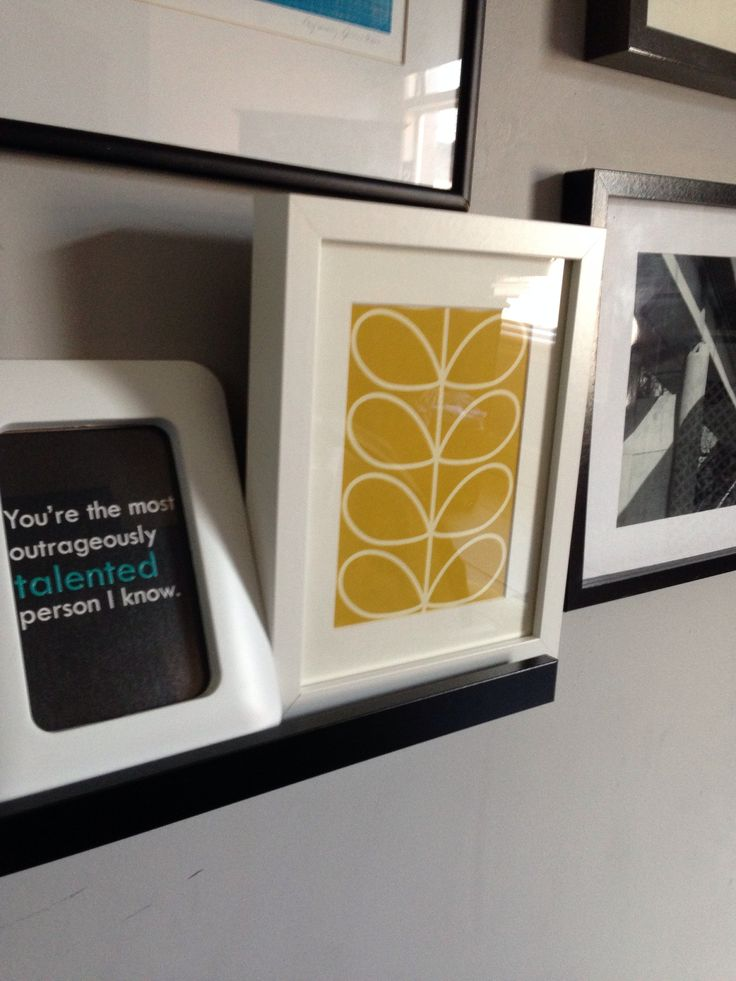 Free Orla Kiely wallpaper sample in an Ikea Ribba frame. Cheap way to add a splash of colour.  Grey bedroom and a splash of yellow.