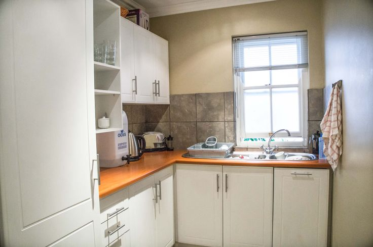 The kitchen with built-in cupboards of this four bedroom property in Paarl.