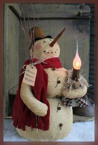 Prim Snowfolk...with a candle light.