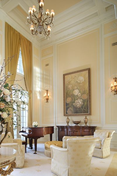 This light & bright space by Diane Durocher is formal without being stuffy. I love the high ceiling, the piano & the elegant yet comfortable feel...V