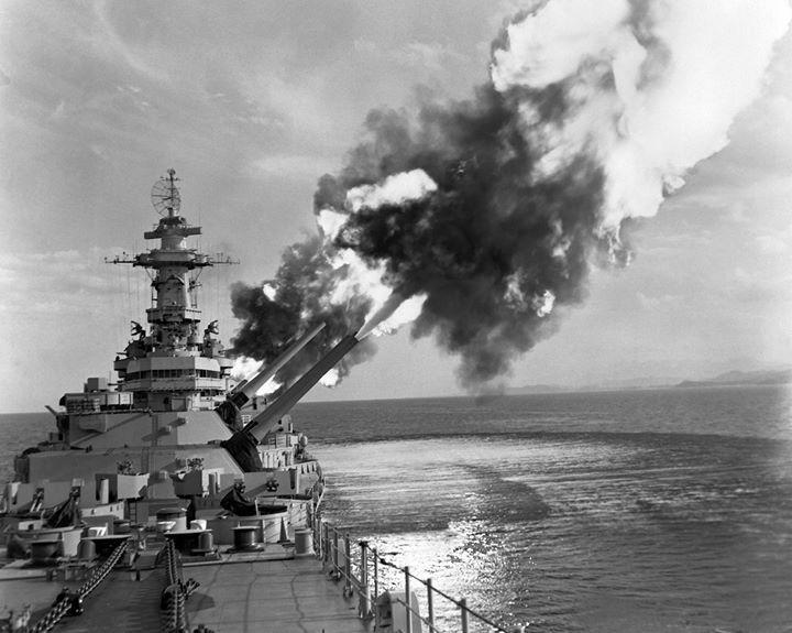 Battleship New Jersey firing a six-gun salvo at an enemy troop concentration near Kaesong Korea 1 January 1953.