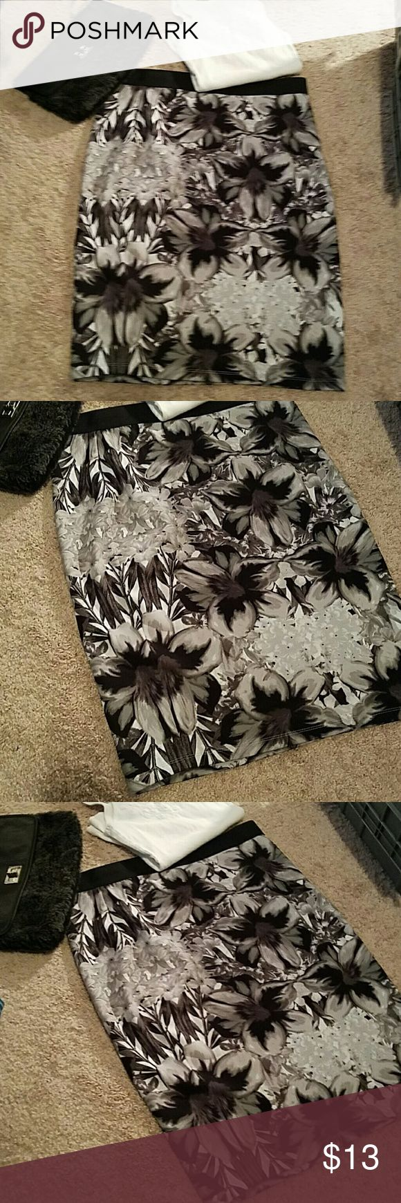 APT. 9 Body Con skirt size XL Black, gray and white flower print, body con skirt by APT. 9 size XL.  Elastic band around waistline.  94% polyester and 6% spandex.  In great preloved condition with very little wear.  Has a lot of stretch could fit up to a 1X in my opinion.  Very comfortable. APT 9 Skirts