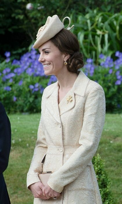 Kate completed her look with the Irish Guards brooch.