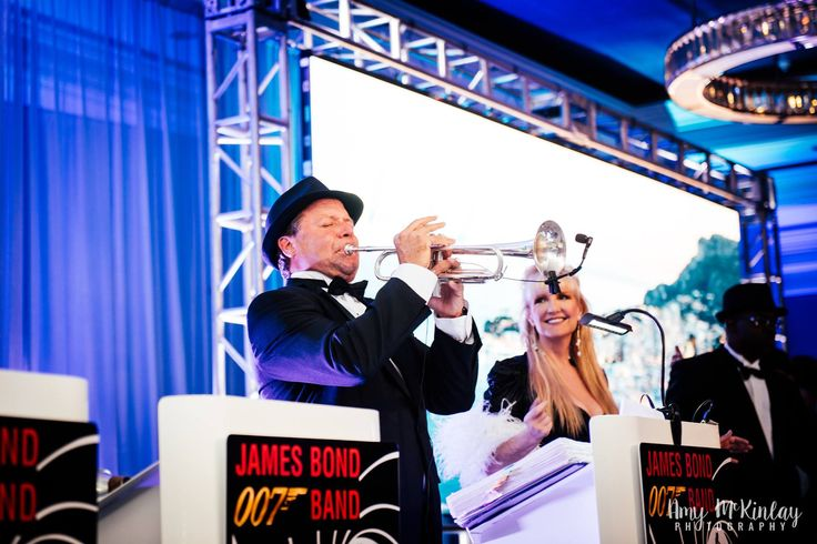 James Bond Entertainment, the 007 Bond Band is based out of Orlando, Florida.  They perform iconic Bond theme songs and more. Americas signature James Bond Band is led by band leader, and trumpet player Mark and is  available from 4 to 12 pieces with sound and lights included, fully insured.   007bondband.com