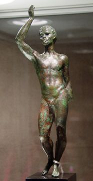Greek bronze figure of an African, Hellenistic Period, circa late 2nd-early 1st Century B.C., 10 1/4