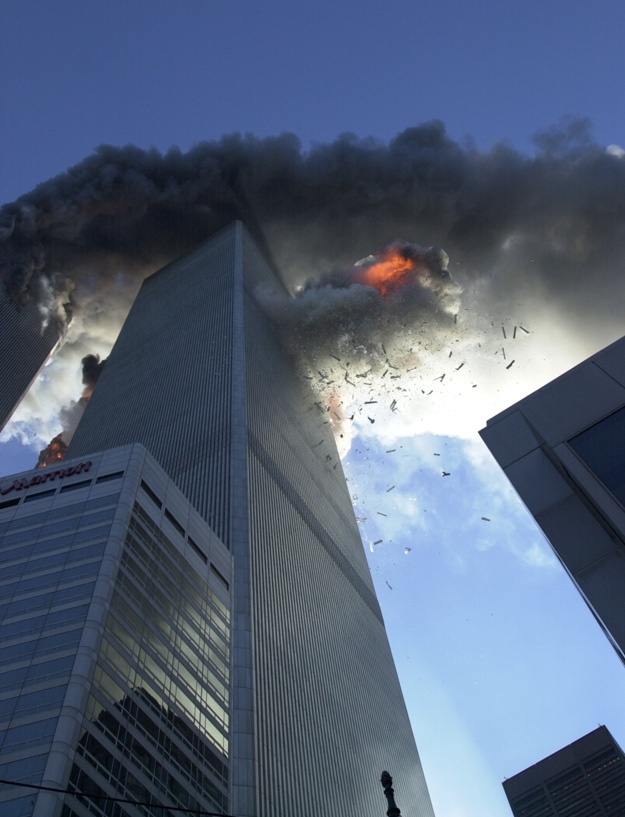 the photographer who took this picture: David Handschuh: When only one plane had hit the World Trade Center, I was going to the site of an airplane crash and this horrible fire burning sixty, seventy floors up. There was no doubt in my mind that the firefighters, paramedics and police officers would put out the fire, rescue people, and everything would be okay. I was standing in front of the south tower when it got hit by the second plane and realized that what happened was very intentional…