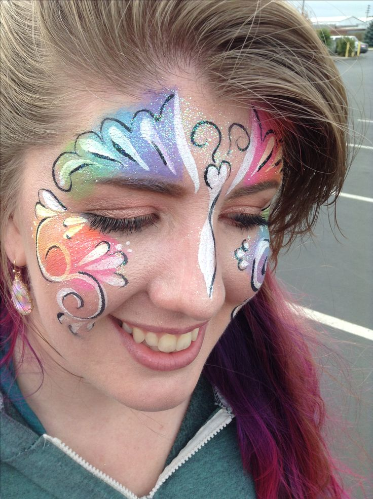 Rainbow butterfly by Kelsey, The Face Painting Lady