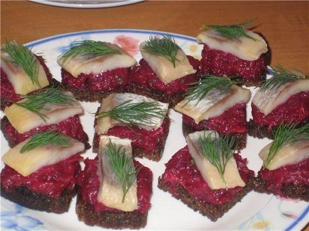 Canapes with beetroot and herring