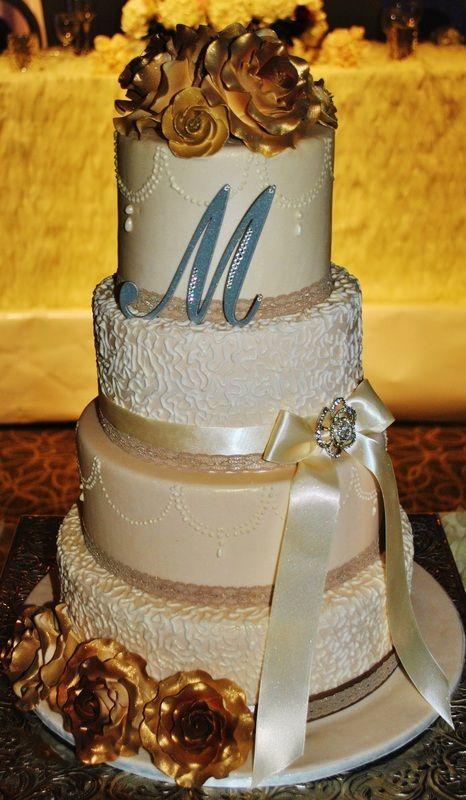 Gold and Ivory Wedding Cake #glamorous #weddingcake #beautiful #love #brideandgroom #flowers #gold #ivory #sweetsisterchicsister