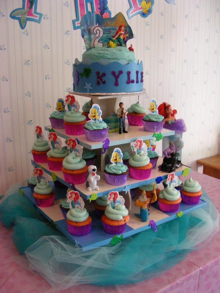 Kylie's 2nd Birthday Square Cupcake Tower Display: http://www.thesmartbaker.com/5-tier-square-cupcake-tower/