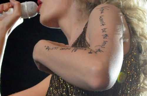 Taylor swifts tattoo on her arm