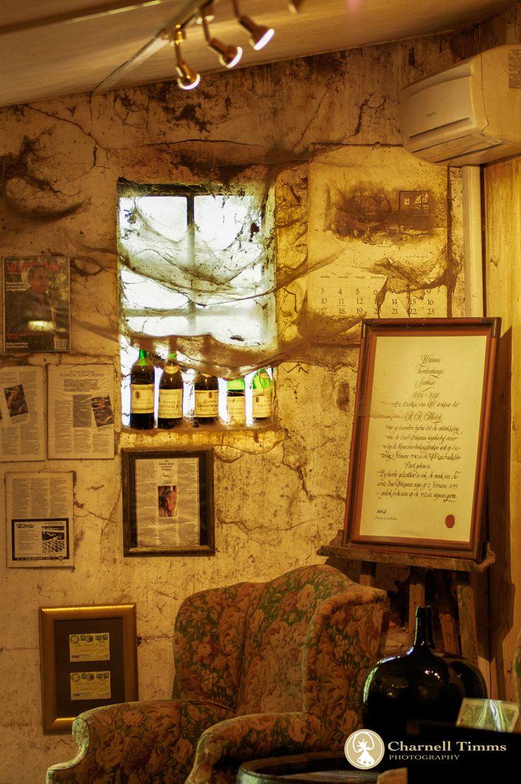 Ancient cobwebbed cellar door of Muratie Wine Estate in South Africa