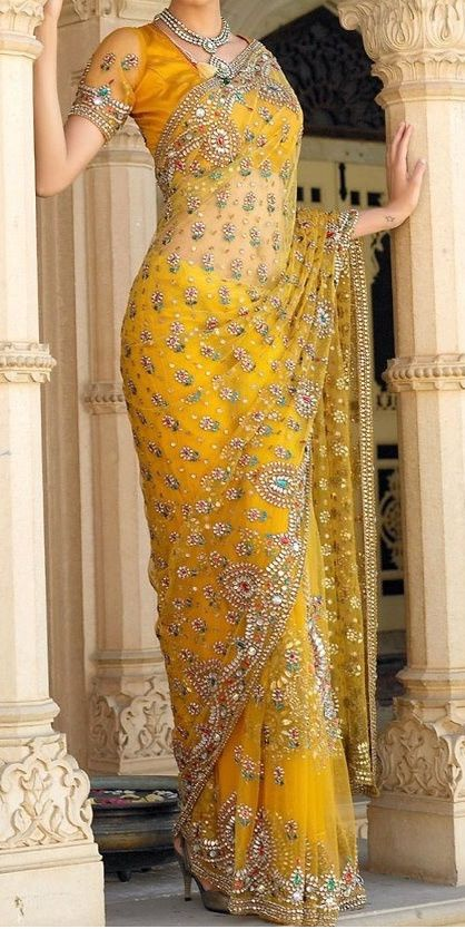 Elegant Saree in net with handcrafted zari and stone work all over. Customized dresses made with high quality fabric & expert workmanship. Images are only for reference. Not our designs. For Custom Bl