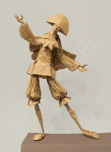 This is paper art in the shape of ( I believe) a type of centuries old Court Jester.
