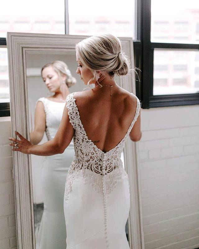 23d834e81e87 This Stella York wedding dress pairs modern simple design with intricate  beaded low back detail.