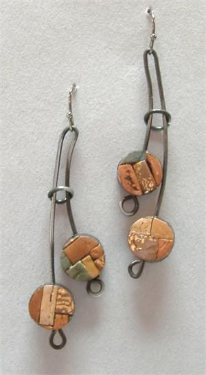.metal wire earrings abstract inspiration for the large loops / circles.