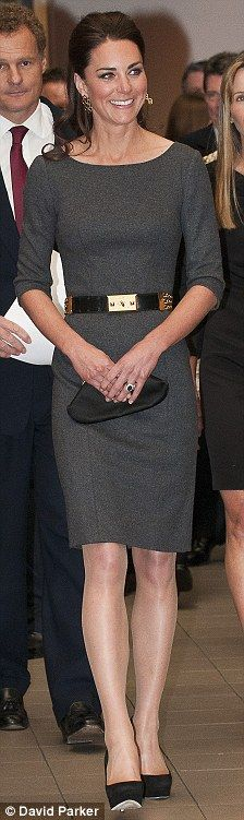 Duchess Catherine in trendy gray dress with bateau neckline & over the elbow sleeves...pencil-skirted sheath..hits just above the knee. Note the belt detailing & its contrast to gray (& matching black pumps)...well styled look of an effortless   style maven.  Dress: Amanda Wakeley