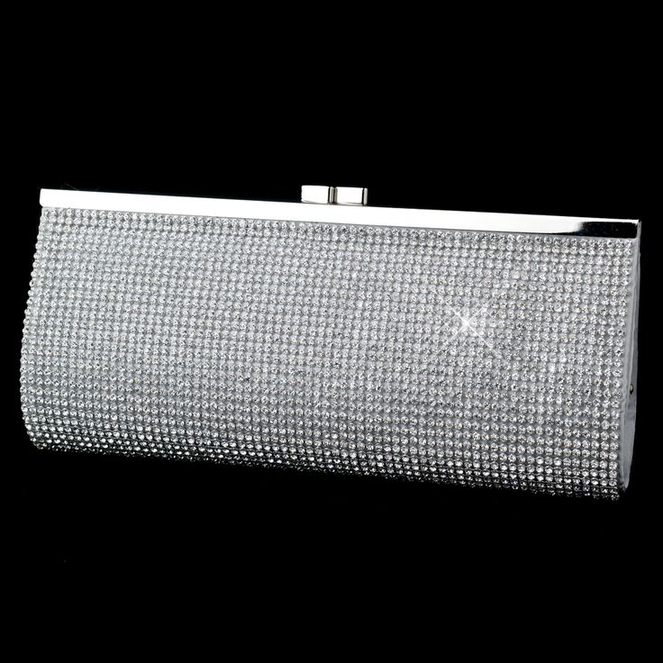 The Cosmo Rhinestone Clutch Evening Bag is a bride favorite that features glistening gemstones by the dozens which effortlessly radiate a sensational burst of eye-catching sparkle that cannot be missed! http://www.elegantbridalhairaccessories.com/shop/bridal-handbags-purses/cosmo-rhinestone-clutch-evening-bag/
