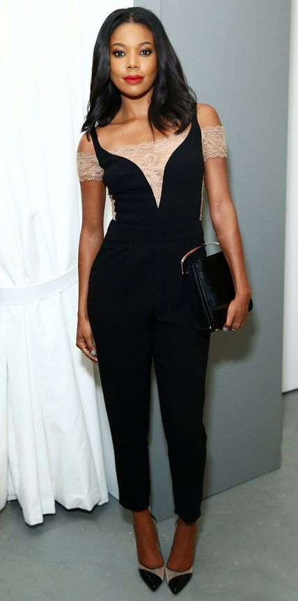 Gabrielle Union took on the NYFW menswear show circuit and stopped by the EFM Engineered for Motion presentation in a sexy-sweet nude lace off-the-shoulder black Noam Hanoch jumpsuit that she styled with a black clutch and nude mesh cap-toe Bionda Castana pumps.