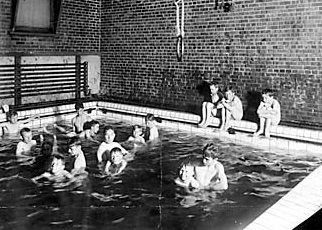 Celebrating 140 Years of Firsts…In this 1910 photograph taken at the Decatur Family YMCA located in Downtown Decatur, boys participate in swim lessons. Mass swim lessons were developed in 1906 by the Detroit YMCA. Today, YMCA's are the largest operator of swimming pools in the world. Our YMCA continues to provide a unique and positive environment focused on teaching swimming techniques. #ymca #throwbackthursday #forabetterus