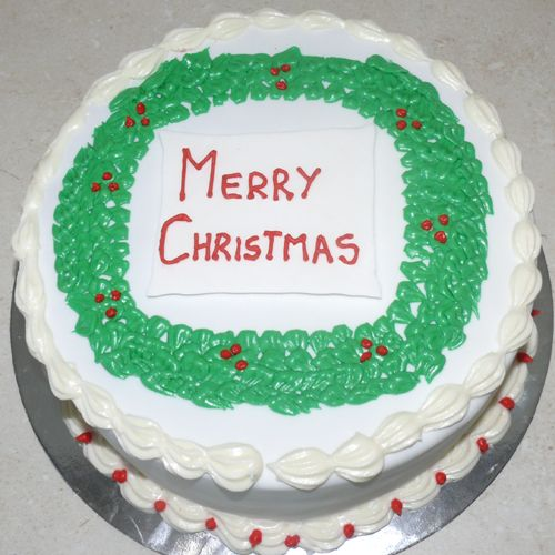 A beautiful traditionally decorated Christmas Cake, ready to make your Christmas sweeter!
