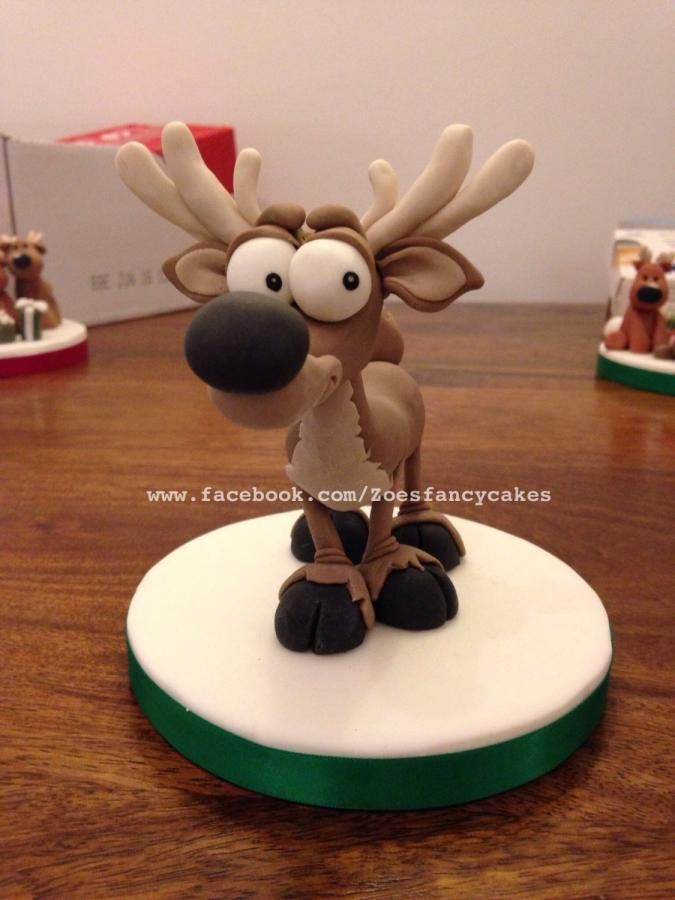 Reindeer cake topper  by Zoe's Fancy Cakes