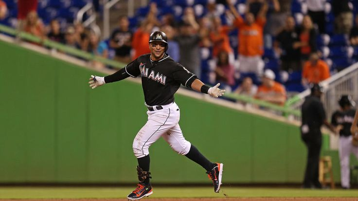May 23, 2015 -- Baltimore Orioles v Miami Marlins. Martin Prado celebrates after hitting a walk-off single to drive in Adeiny Hechavarria during the thirteenth inning.  Martin Prado's walk-off single gives the Marlins a 1-0 victory over the Baltimore Orioles. (Rob Foldy / Getty Images)