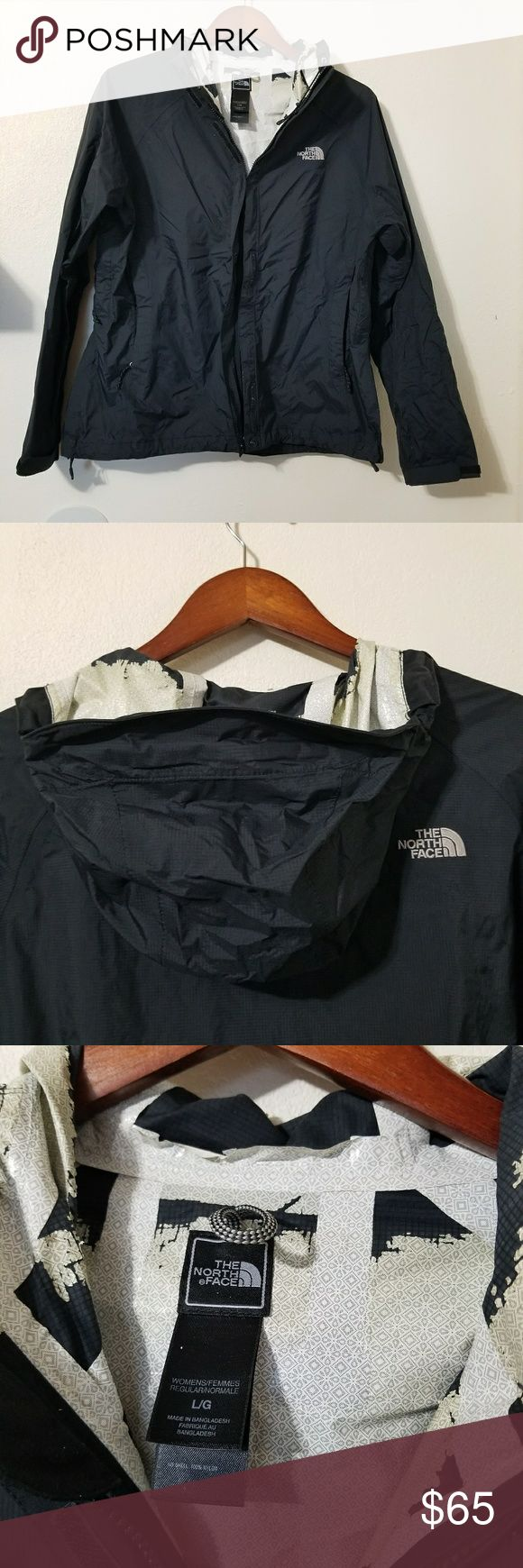 The North Face Classic Black Zip Rain Jacket Large Womens rain jacket with full zip with velcro. Zip pockets. Adjustable drawstring hem. Hood with extended visor to keep the rain out. Peeling on the inside from the wash. Still great condition on the outside! Tagged as a womens large. The North Face Jackets & Coats