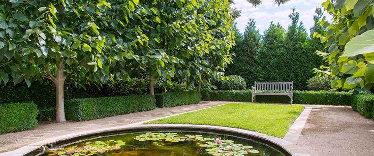 Circular Pond in one of our Classical Gardens - Eugene Gillgan Garden Design