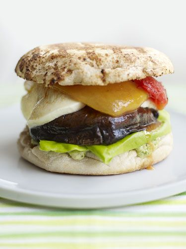 """A vegetarian twist on a classic favorite, these juicy """"burgers"""" still pack plenty of protein, minus the saturated fat. Grilled Portabella Burgers with Pesto Mayo"""