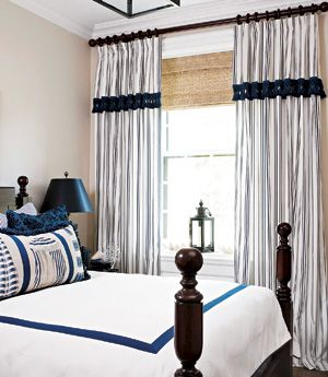 Natural woven shades add texture to this blue and white room.