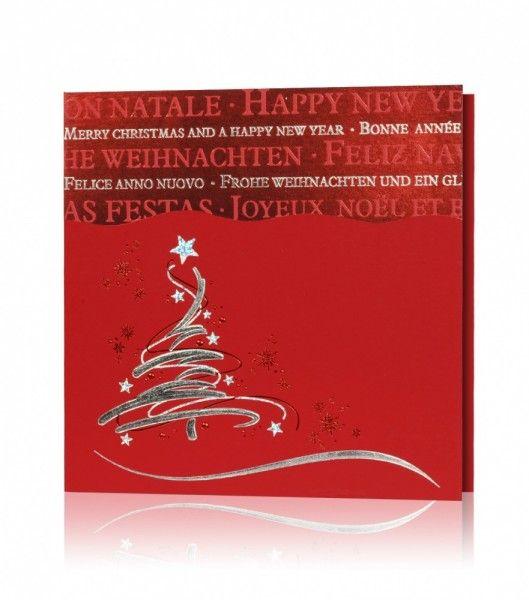 Czerwony papier, srebrny i czerwony nadruk. Na kartce świątecznej widnieje stylowa choinka przyozdobiona gwiazdkami, w tle delikatne śnieżynki. Górna część kartki ma nadrukowane teksty życzeń w różnych językach.
