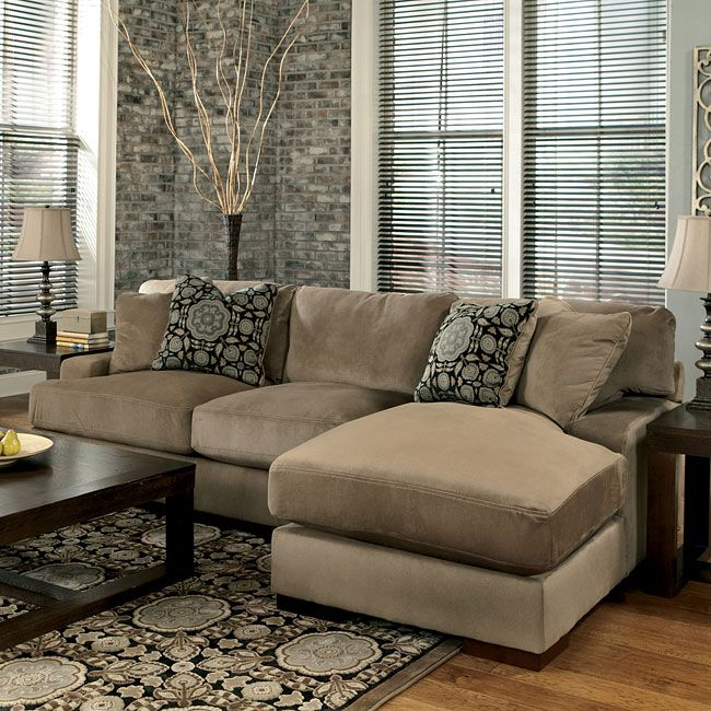 With the oversized set-back arms and comfortable pillow back design, the stylish contemporary look of the Grenada - Mocha Right Chaise Small Sectional by Millennium by Ashley Furniture is the perfect fusion of style and comfort with a variety of set up options to suit the needs of any living room. Part of the Grenada - Mocha Small Sectional Set by Millennium by Ashley Furniture.