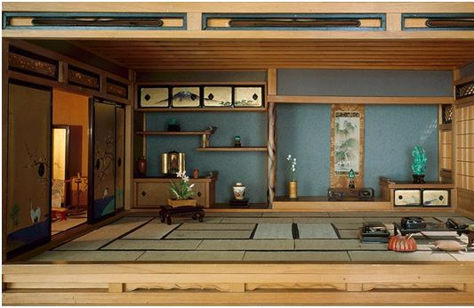 A traditional Japanese interior, complete with tokonoma (a built-in recessed space) displaying some choice pieces of art and ikebana, sliding doors opening onto a garden, and tatami mats. The very picture of wabisabi.