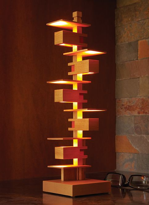 Mini Taliesin III Lamp: A scaled down, decorative version of Wright's Taliesin III lamp, it is made of finely-crafted Cherry wood with a Cherry-tinted Danish oil finish. LED lights are powered by 4 AAA batteries with a switch, hidden in the base.