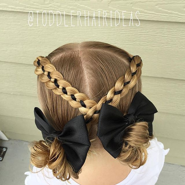 """""""Today we did simple and festive criss crossing 4-strand ribbon braids into messy buns. Messy bun and 4 strand braid tutorials are on my YouTube channel, link in bio!"""