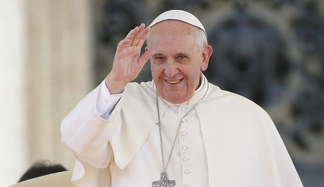 Pope Francis waves as he arrives to lead a special audience with engaged couples,February 14, 2014.