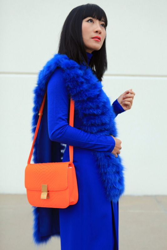 blue coat, orange purse