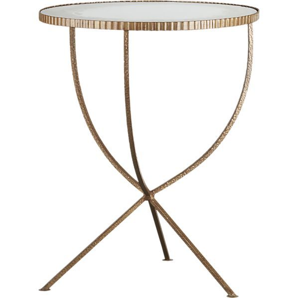 2 mirrored metal tables as nightstands. http://cococozy.com