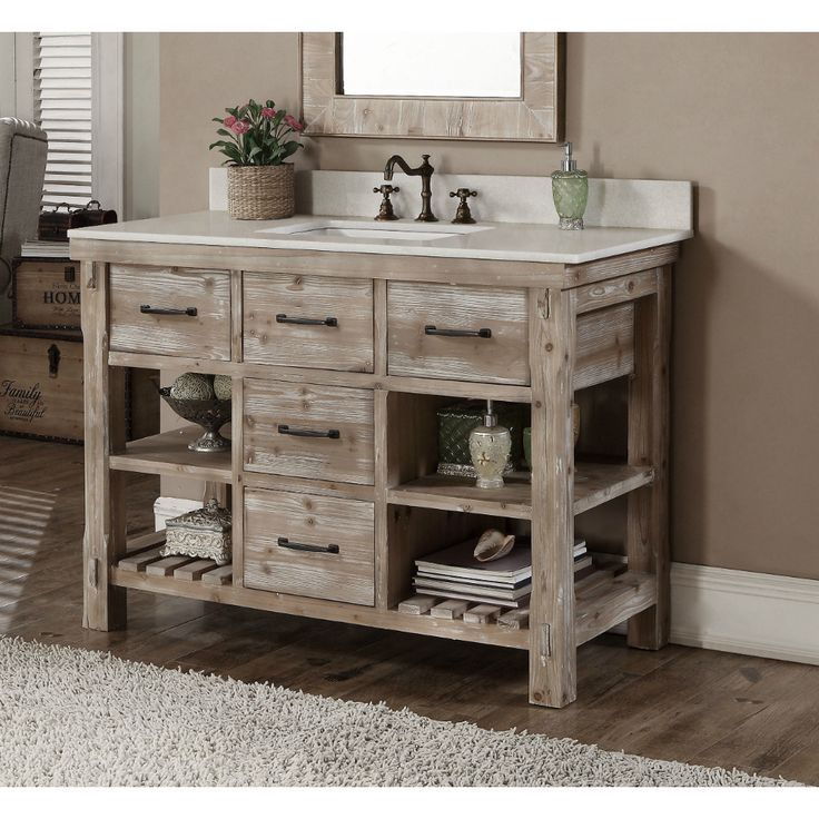 This rustic style bathroom vanity features with tip out tray, soft-closing drawres, natural stone top with backsplash and white ceramic sink.