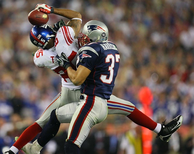"As the Giants and Patriots prepare to face off on Sunday, SI looks back at David Tyree's famous catch in Super Bowl XLII. SI's Damian Strohmeyer, who took the above photo, reminisces on the famous play:  ""From a photographer's standpoint it captures all you want in a photo. Nice photo of a key moment in the game.As a photographer I had one of those moments in which you can't believe this is happening to me while the play was going on. Super Bowl security was getting"