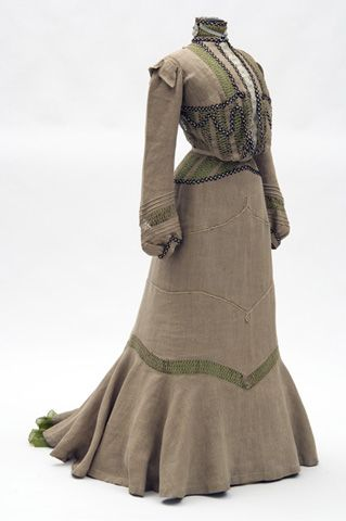 Two-piece natural colored linen dress with green silk underslip. Linen fabric purchased in Cuba and dress constructed by the Misses Leonard, St. Paul dressmakers. 1901.